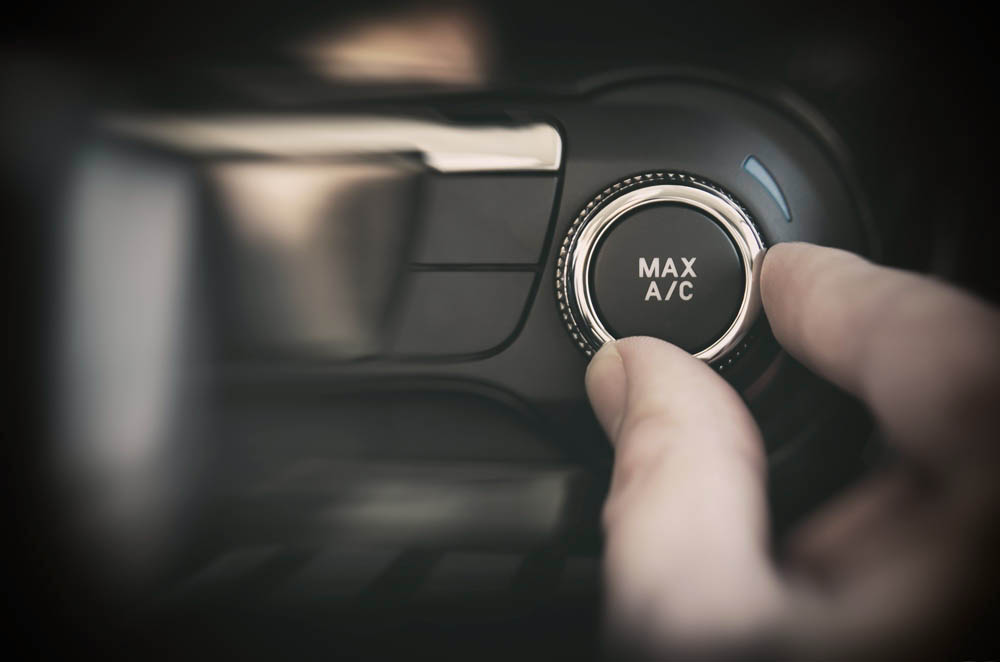 person adjusting air conditioning